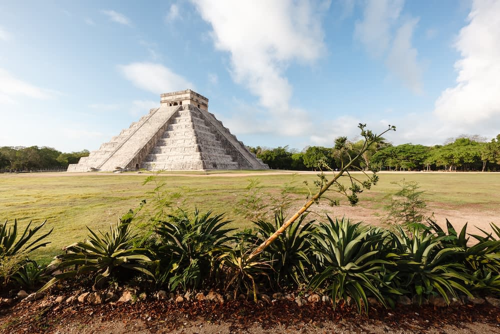 Landscape view of Chichen Itza, ancient Mayan site on a sunny day.