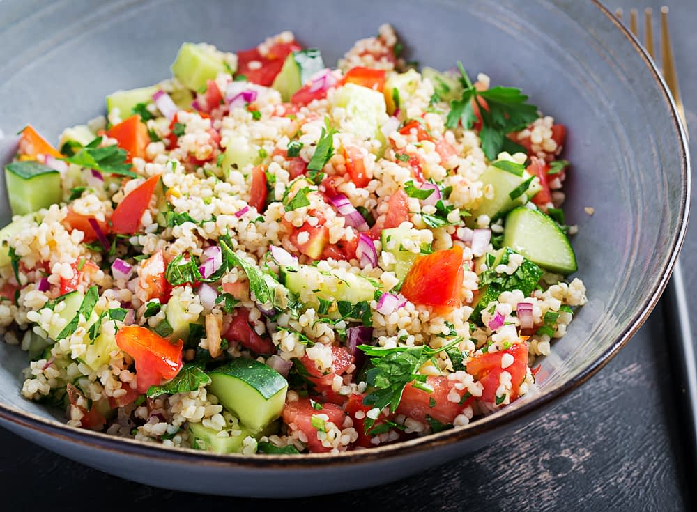 Tabouleh salad with parsley, cucumber, tomato, and red onion