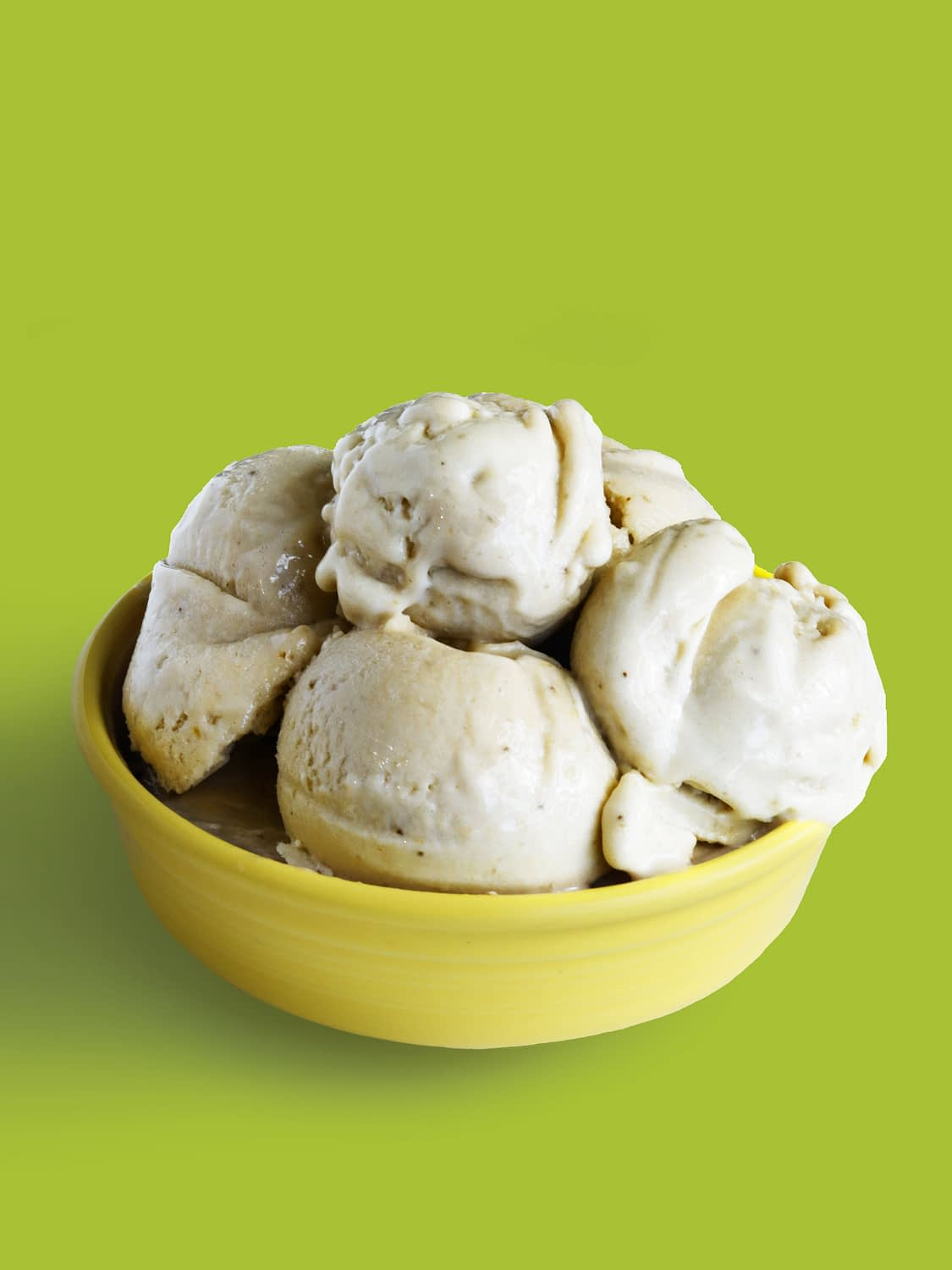 creamy banana nice cream in a yellow bowl for a Healthy summer treat