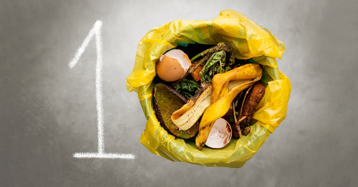 A one next to a round trash can full of food waste, together forming the number 10