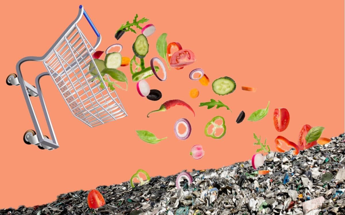 Chopped vegetables fall from a shopping cart into a pile of garbage, food waste, food shelf life