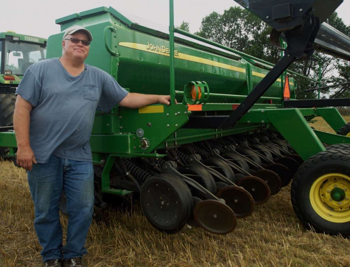 Gabe Brown stands in front of his no-till tractor in Kiss the Ground
