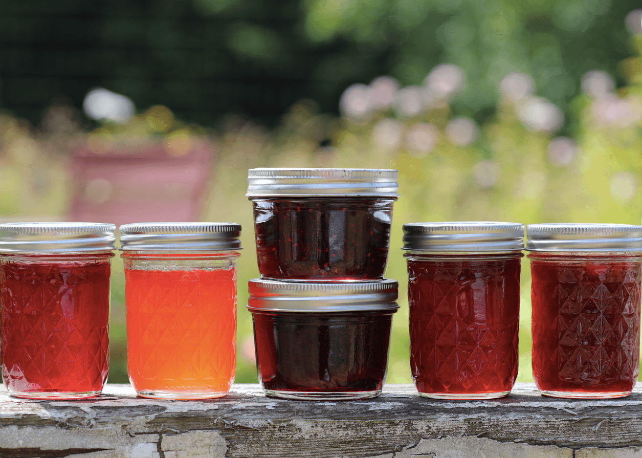 a variety of jams and jellys perfect for a farmers market charcuterie board