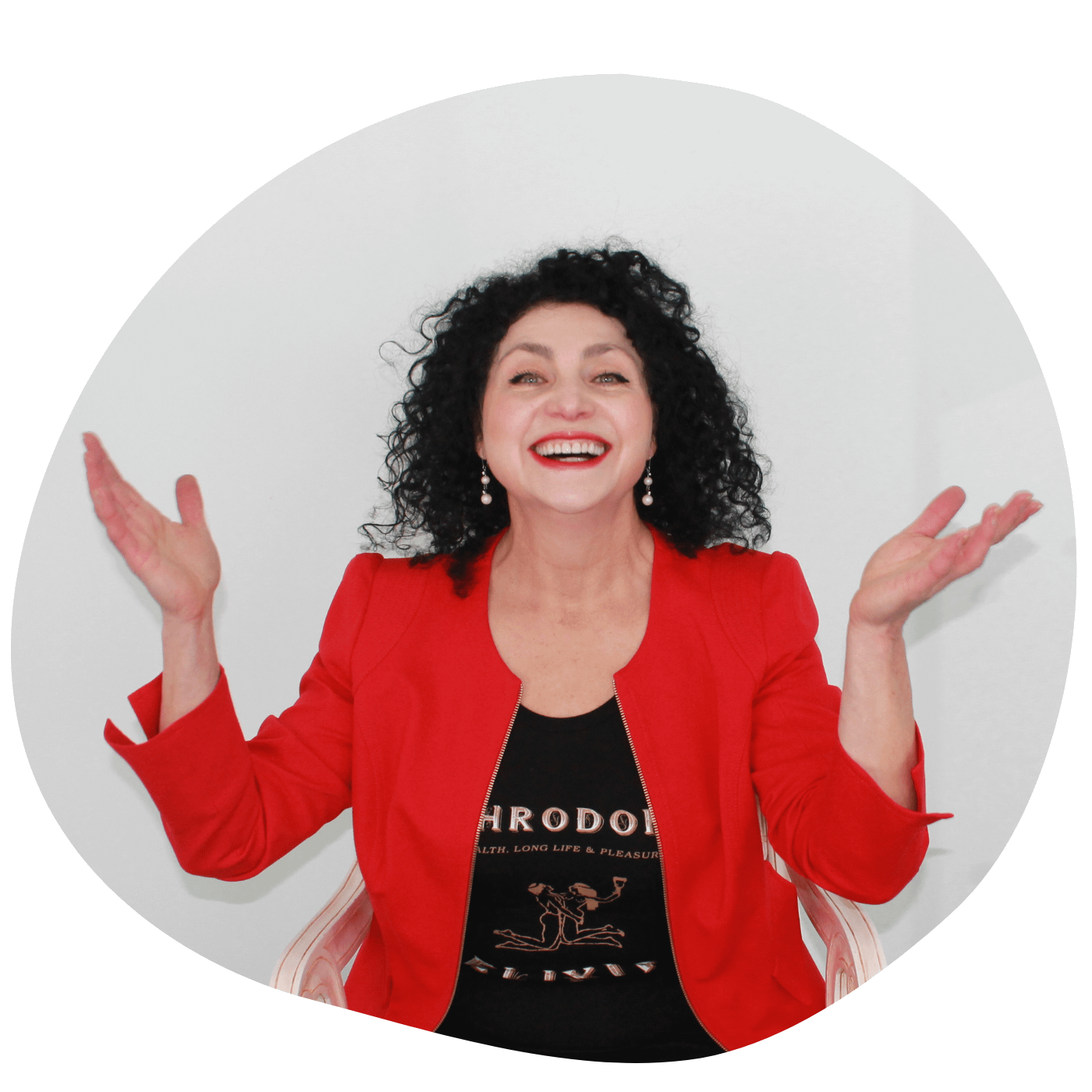 Lillian Zeltser poses in a red blazer with her hands raised and smiling