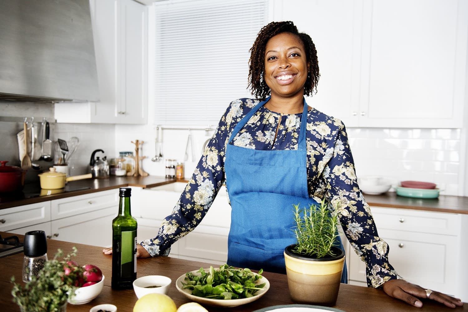 woman in the kitchen with herbs