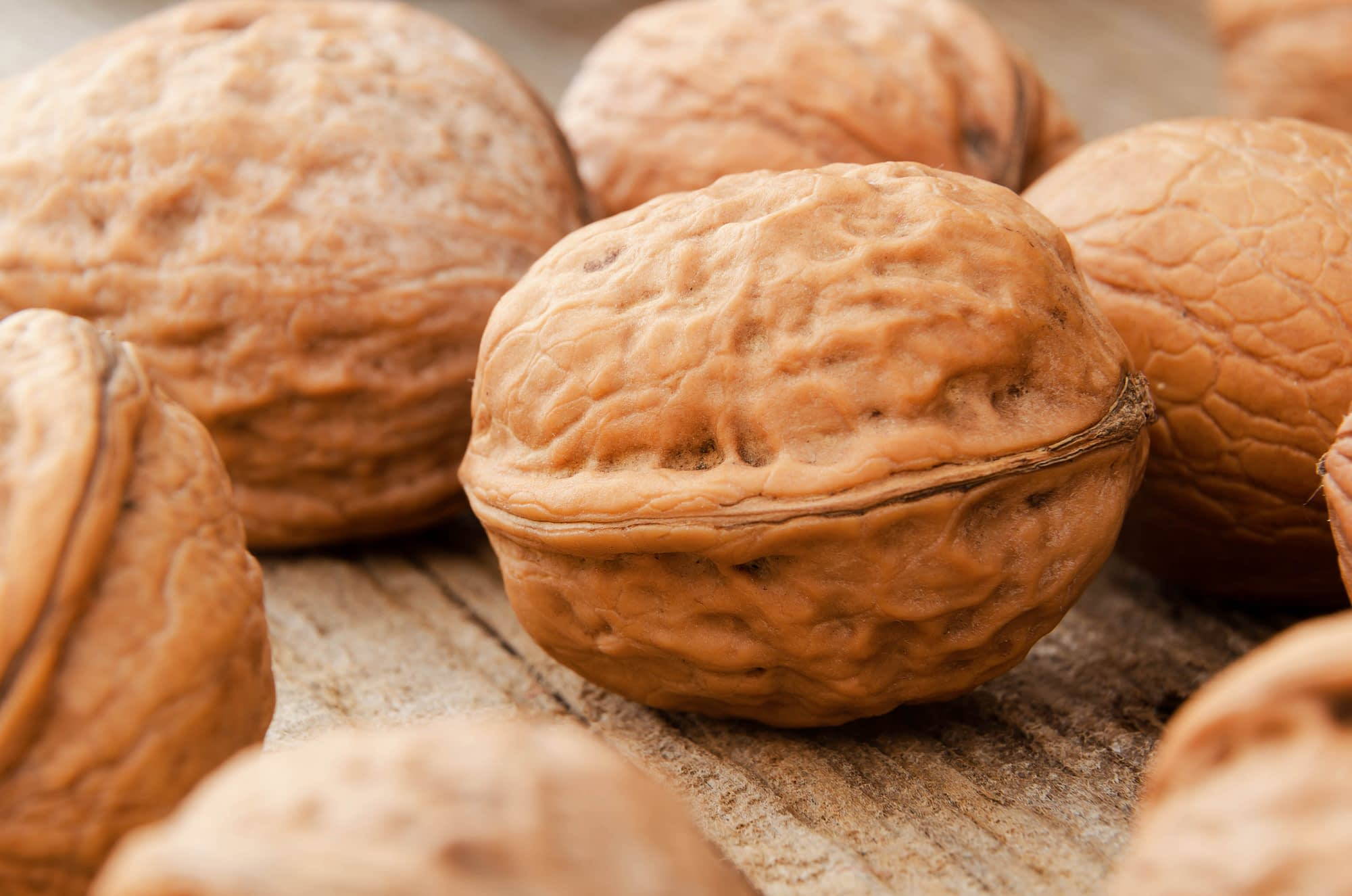 Close up of English Walnuts on a wooden table.