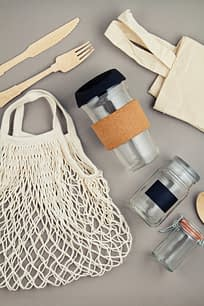 eco-friendly reusable bags, utensils, jars, and cups