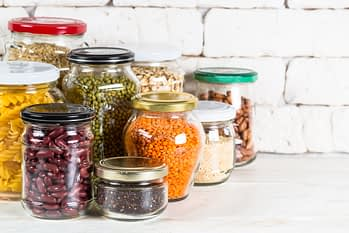 pantry items like beans, lentils, and legumes in glass jars