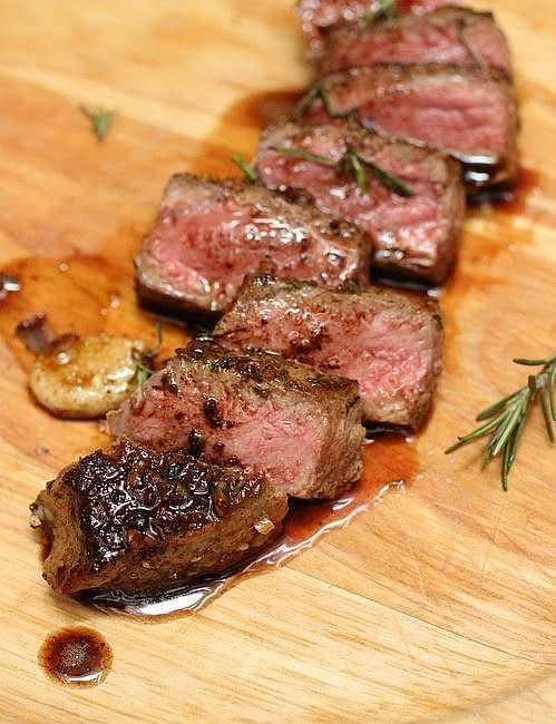 Juicy steak slices with rosemary