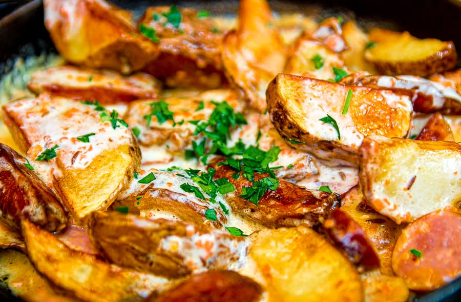 A healthy Poutine with Sweet potato strips and cream Cheese baked in an oven