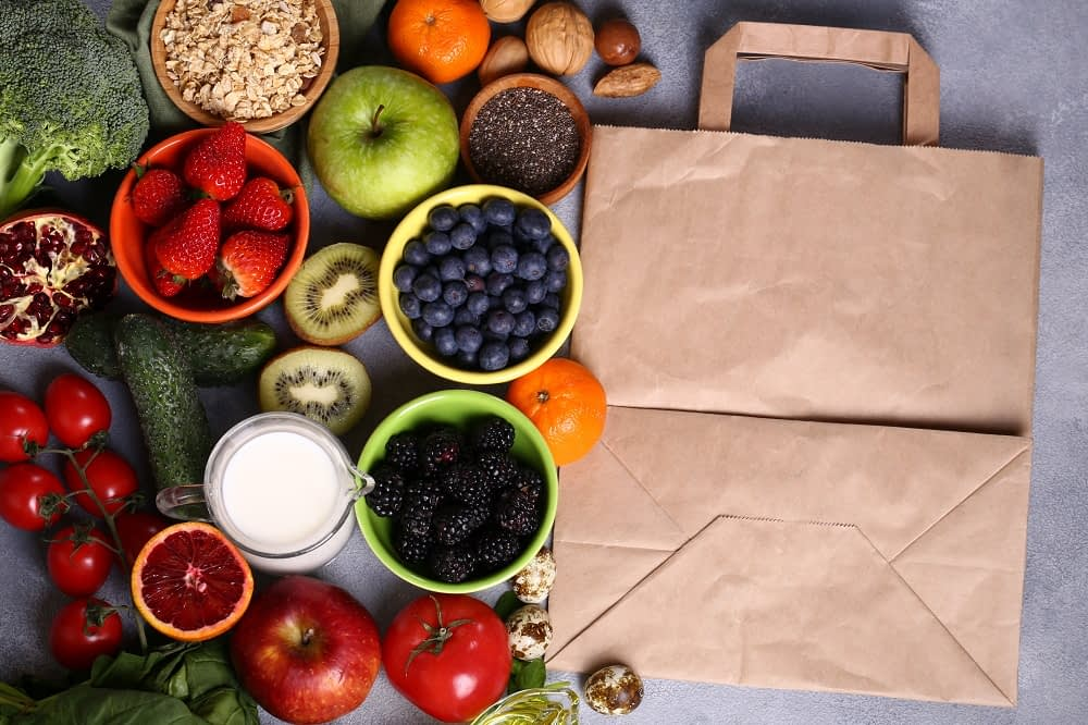 delivery bag next to berries fruits vegetables for a healthy diet
