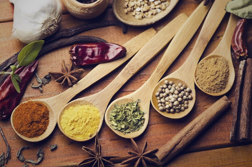 Colorful spices in wooden spoon