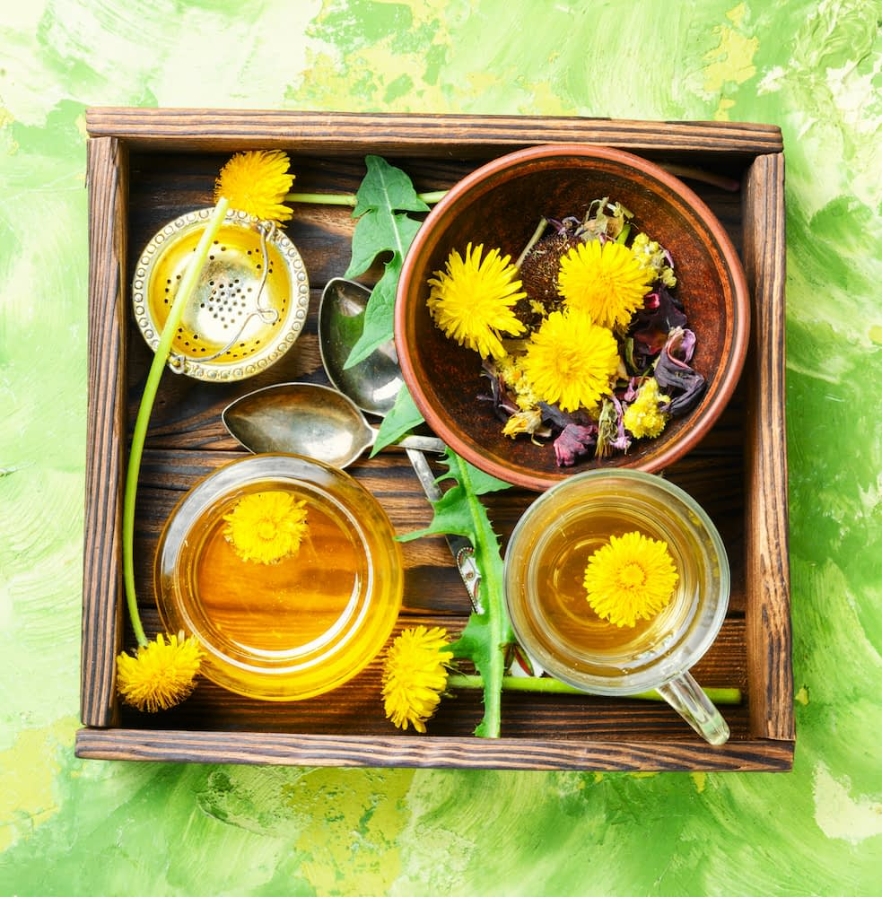 A bowl of honey with dandelion salad and tea.