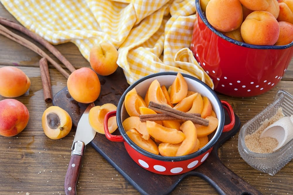 Pot with peaches in it for peach jam