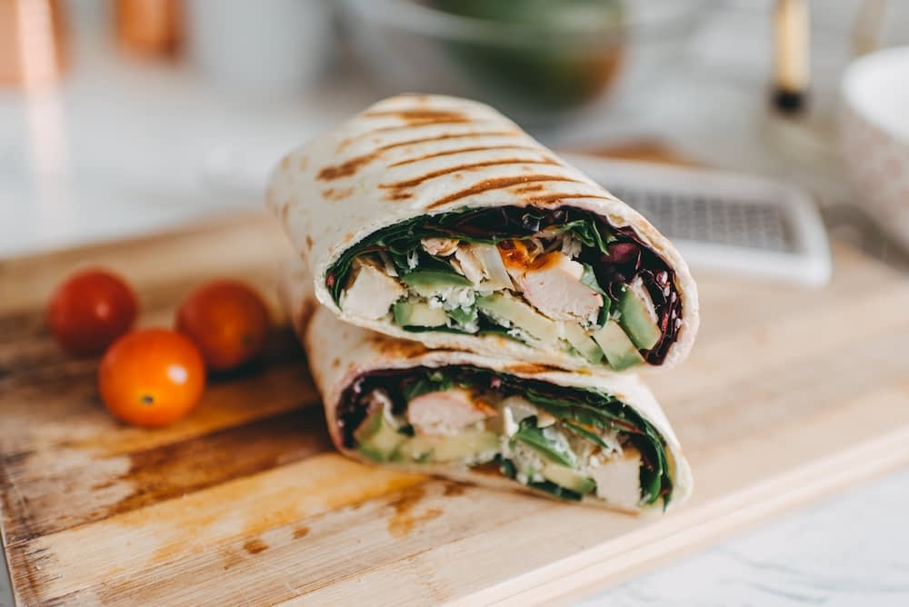 Leftover chicken in a wrap with vegetables and avocado