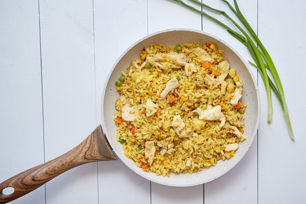 Fried rice with chicken and vegetables in a non-stick pan