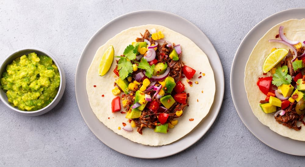 soft chicken taco with chicken, avacado, corn, tomatoes and red onions