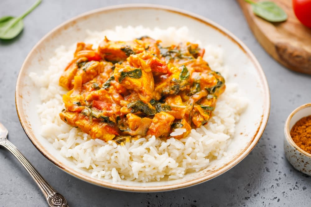 Tasty and hot leftover chicken curry with white rice