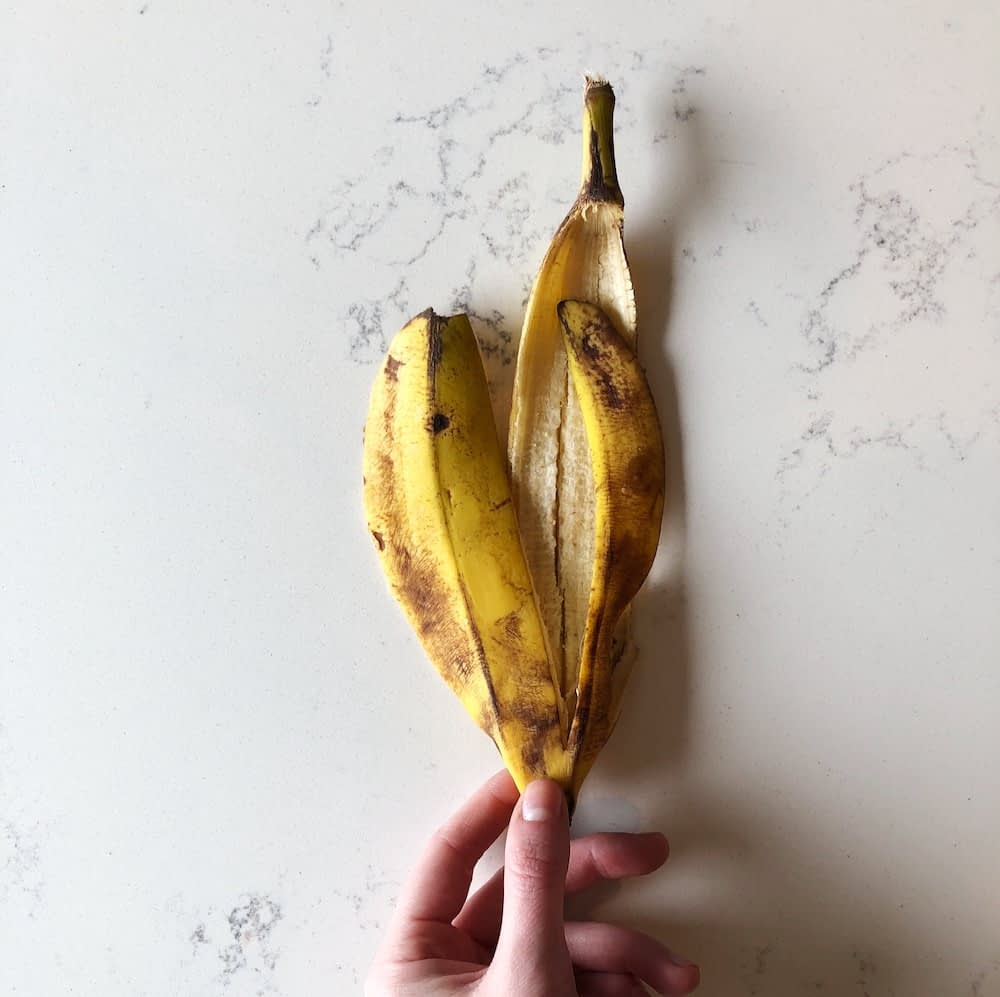 a banana peel is a great food scrap for your garden