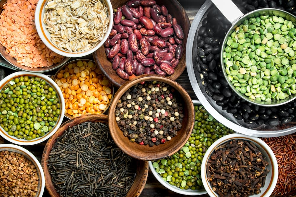 Healthy grains and legumes like red beans, lentils, wild rice, oats, and split peas
