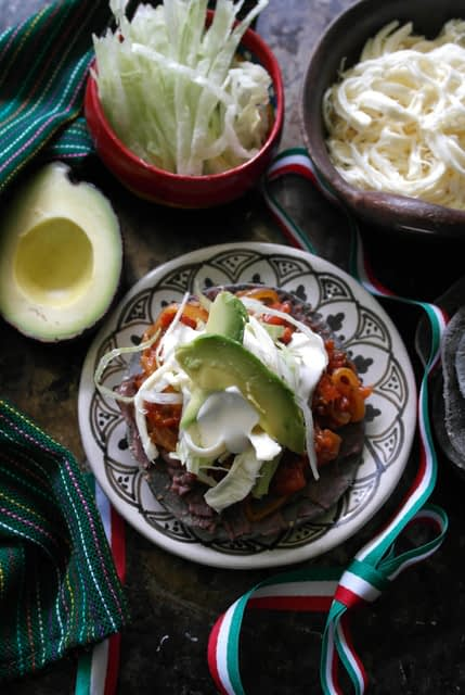 Serving of vegetarian Tinga Tostadas on plate, authentic Mexican cuisine.